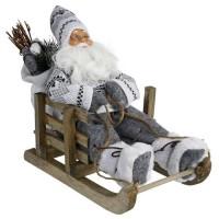 Décoration a poser Pere Noël sur luge 128445C - H30 cm