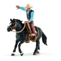 Schleich Figurine 41416 - Animal de la ferme - Selle western avec un cowboy